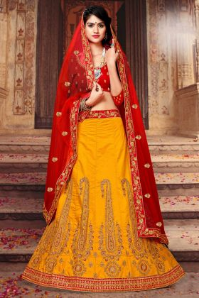 Art Silk Wedding Lehenga Choli Thread Embroidery Work In Yellow Color With Red Net Dupatta