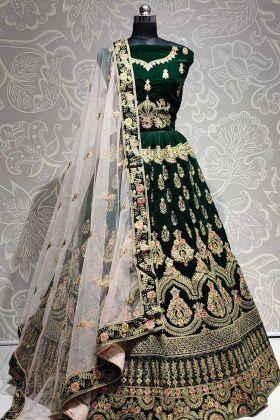 Attractive Dark Green Velvet Lehenga Choli With Heavy Dupatta
