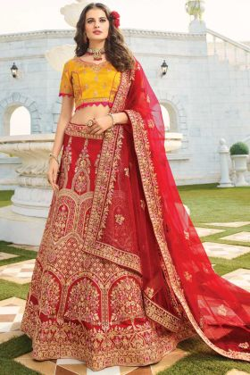 Attractive Maroon Raw Silk Lehenga Choli With Heavy Dupatta