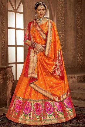 Banarasi Silk Orange Lehenga Choli With Heavy Weaving Work