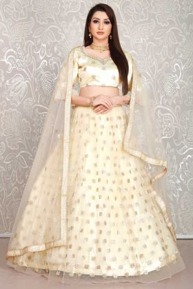Bridal Wear Beige Color Net Lehenga Choli In Embroidery Work