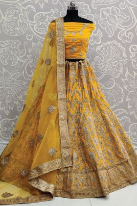 Bridal Wearing Heavy Embroidered Satin Silk Mustard Lehenga Choli