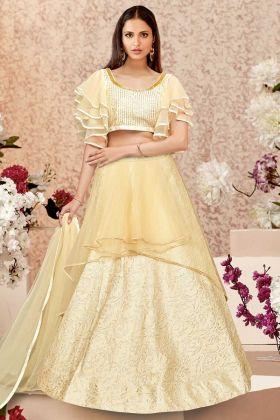 Cream Color Jacquard Silk Lehenga Choli With Zari Embroidery Work
