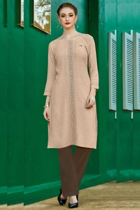 Cream Color Rayon Flex Designer Kurti With Schiffli Work