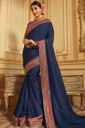 Dark Rani Blouse Pattern With Navy Blue Jacquard And Raw Silk Saree