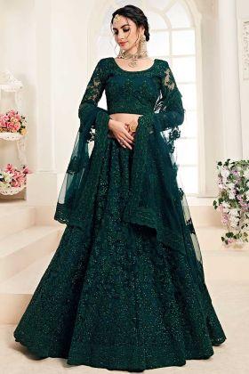 Dark Green Wedding Wear Lehenga In Net And Silk Fabric