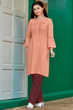 Dark Peach Color Rayon Flex Stylish Kurti With Schiffli Work