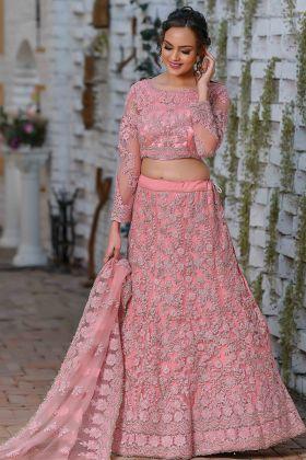 Demanding Light Pink Color Net Fabric Wedding Wear Lehenga Choli