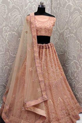 Demanding Peach Color Bridal Net Wedding Wear Lehenga Choli