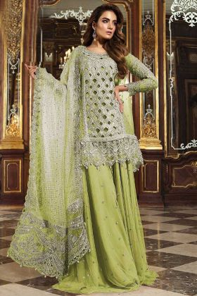 Designer Heavy Net Party Wear Sharara Suit With Pista Color