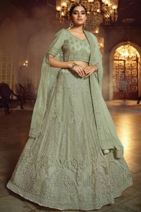 Elegant Looking In Green Soft Net Lehenga Choli With Zarkan Work