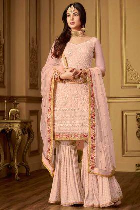 Embroidery Work Net Sharara Salwar Kameez In Peach Color