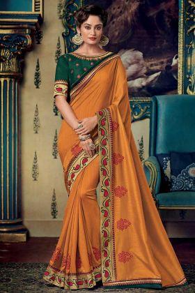 Embroidery Work Orange Color Fancy Fabric Designer Saree