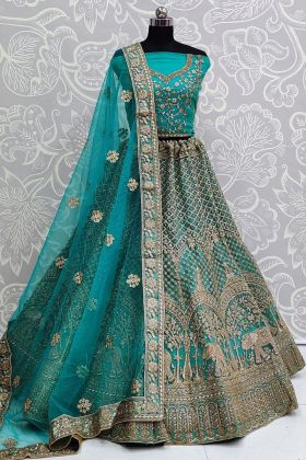 Entrancing Soft Net Embroidered Heavy Bridal Lehenga In Firozi Color