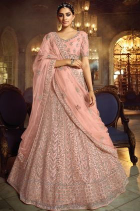 Eye Catching Soft Net Peach Color Heavy Lehenga Collection With Zarkan Work