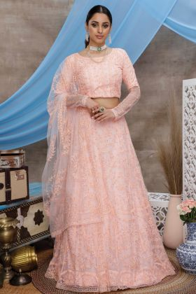 Fancy Party Wear Peach Color Net Lehenga Choli