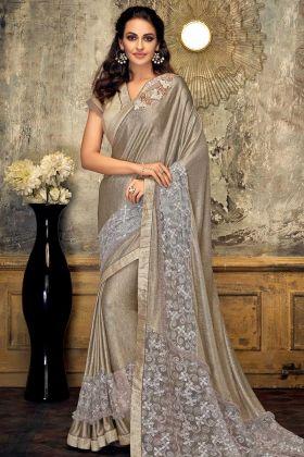 Fancy Lycra And Embellished Net Saree Gold Color