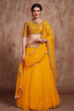 Fancy Musturd Yellow Jari Embroidery Net Festival Lehenga Choli