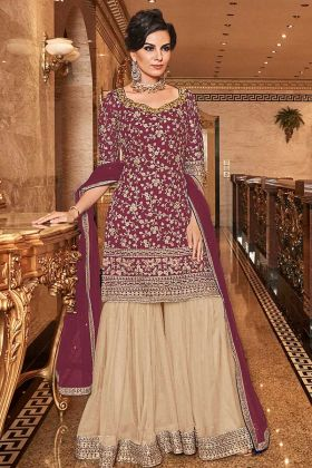 Fashionable Net Designer Sharara Suit In Wine Color