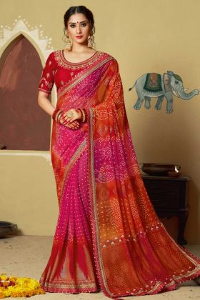 Faux Georgette Bandhani Saree Stone Work Pink  and Orange Color