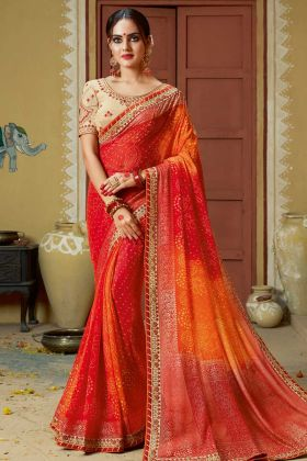 Faux Georgette Bandhej Saree Red and Orange Color With Lace Border