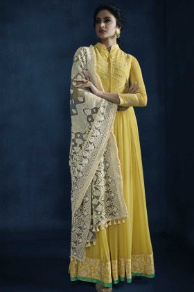 Faux Georgette Designer Salwar Suit With Lace Yellow Color