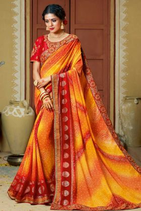 Faux Georgette Festival Bandhej Saree Orange and Red Color With Stone Work