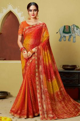 Faux Georgette Traditional Bandhani Saree Orange and Red Color With Lace Border