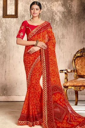 Faux Georgette Traditional Bandhani Saree Zari Work Orange and Red Color