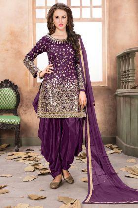 Festive Wear Purple Patiala Style Salwar Suit In Taffeta Silk Fabric With Mirror Work
