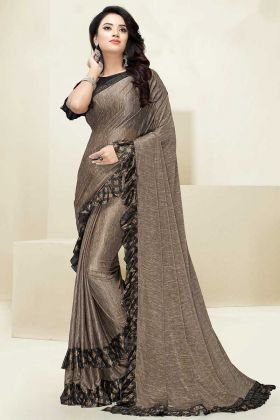 Foil Print Work Beige Color Fancy Fabric Party Wear Ruffle Saree