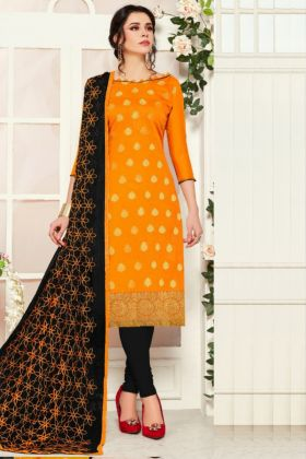 Get Elegant Looking In Mustard Colored Banarasi Silk Dress Material