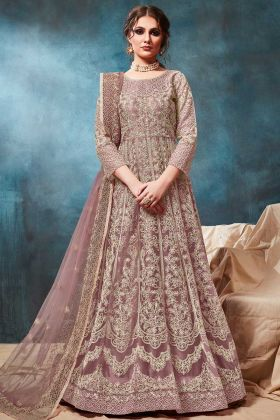 Get Traditional Looking In Light Purple Color Soft Net Anarkali Heavy Suit