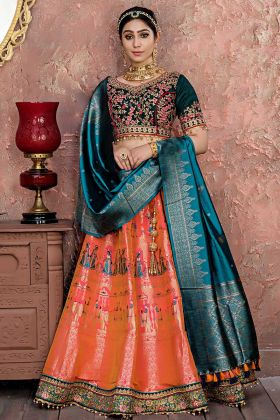 Good Looking Orange Pink Color Zari Banarasi Silk Party Wear Lehenga Choli