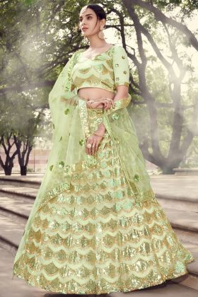 Gorgeous Pista Green Colored Soft Net Wedding Lehenga Collection 2021