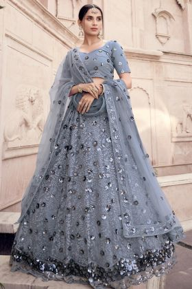 Grab Elegant Look In Soft Net Grey Colored Lehenga Choli For Engagement