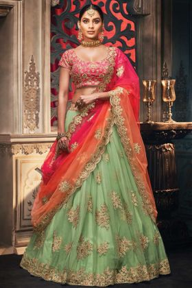 Heavy Pista Color Net Party Wear Lehenga In Embroidery Work