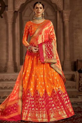 Heavy Weaving Work Banarasi Silk Festival Lehenga Choli In Orange and Pink Color