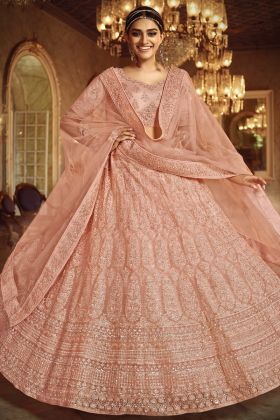 Highly Demanded Peach Color Soft Net Lehenga Choli With Zarkan Work