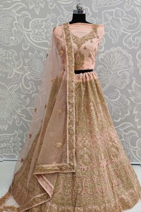 Indian Wedding Lehenga Design In Peach Color Net Fabric