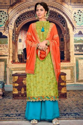 Jacquard Palazzo Salwar Suit In Heavy Embroidered Work Firozi Color