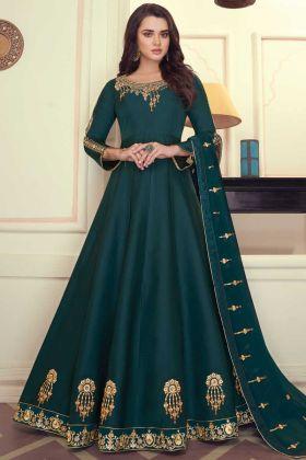 Latest Heavy Malin Silk Dark Party Wear Green Anarkali Suit