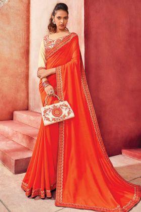 Latest Partywear Orange Color Chanderi Silk Saree With Heavy Border