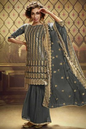 Most Demanding Heavy Designer Grey Color Soft Net Salwar Dress