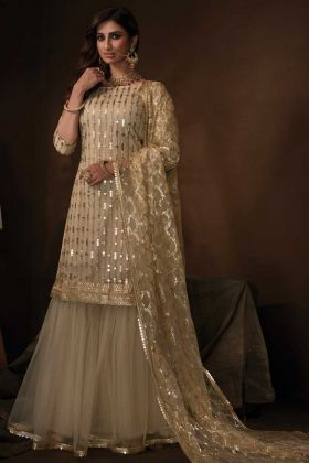 Mostly Like Dusky Beige Color Soft Net Festive Wear Sharara Suit