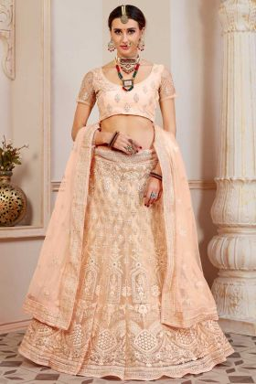 Net Light Peach Party Wear Lehenga With Resham Embroidered