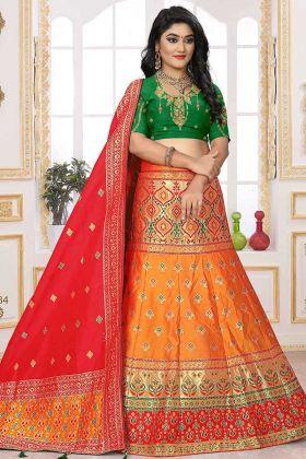 Orange Silk Jacquard Lehenga With Green Raw Silk Blouse