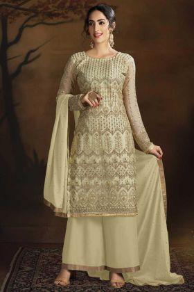 Party Wear Net Fabric Cream Color Salwar Suit