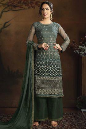 Party Wear Net Fabric Dark Green Color Salwar Suit