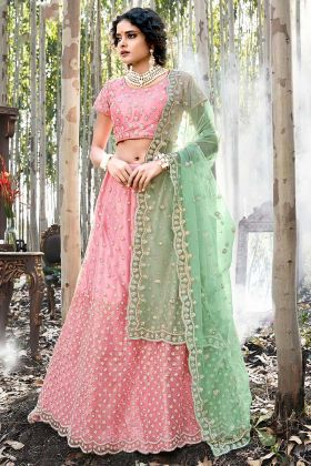 Pink Net Wedding Lehenga In Embroidered Work